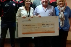 Murt Murphy Donation of €870 from the annual Andrew Murphy Memorial Cup. Back Row: Members of Shelbourne FC Front Row: Deirdre Caulfield (Board Member of NRCH), Murt Murphy and Joan Byrne (NRCH).
