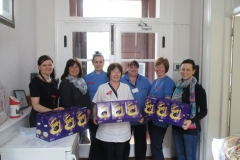 Staff of New Ross Community Hospital happily accepting gifts from Lake Region.